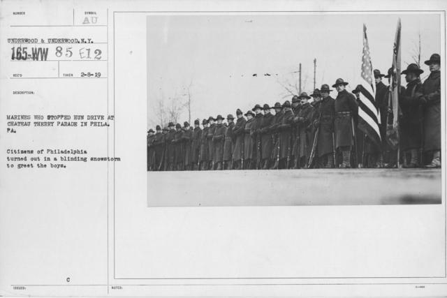 Ceremonies and Parades - Marines who stopped Hun drive at Chateau Thierry parade in Phila. PA.  Citizens of Philadelphia turned out in a blinding snow storm to gree the boys