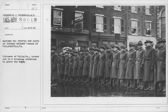 Ceremonies and Parades - Marines who Stopped Hun drive at Chateau Thiery parade in Philadelphia, PA.  Citizens of Phila. Pa., turned out in a blinding snowstorm to greet the boys