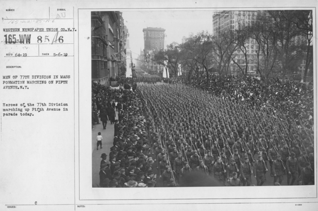 Ceremonies and Parades - Men of 77th Division in mass formation marching on Fifth Avenue, N.Y.  Heroes of the 77th Division marching up Fifth Avenue in parade today