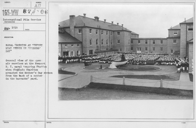 """Ceremonies and Parades - Naval Recruits at Newport hear sermon on """"Mothers' Day"""".  General view of the open air services at the Newport, R.I. Naval Training Station when Chaplain Charlton preached the Mother's Day sermon from the back of a cutter in the barrack's yard"""
