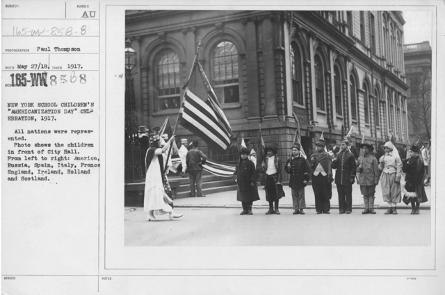 "Ceremonies and Parades - New York School Children's ""Americanization Day"" Celebration, 1917.  All nations were represented.  Photo shows the children in front of City Hall.  From left to right:  America, Russia, Spain, Italy, France, England, Ireland, Holland, and Scotland"