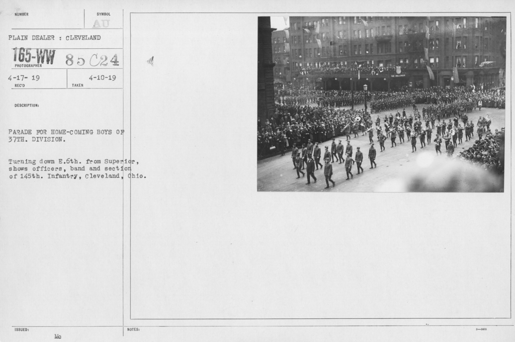 Ceremonies and Parades - Parade for home-coming boys of 37th Division.  Turning down E. 6th from Superior, shows officers, band and section of 15th Infantry, Cleveland, Ohio
