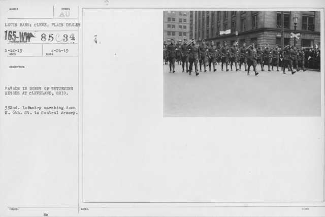 Ceremonies and Parades - Parade in honor of returning heroes at Cleveland, Ohio.  332nd Infantry maching down E. 6th St. to Central Armory