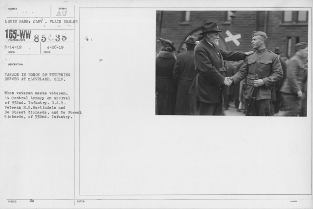 Ceremonies and Parades - Parade in honor of returning heroes at Cleveland, Ohio.  When veteran meets veteran.  At Central Armory on arrival of 332nd Infantry.  G. A. R. Veteran H. C. Martindale and De Forest Richards, and De Forest Richards of 332nd Infantry