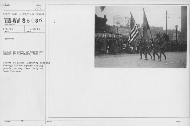 Ceremonies and Parades - Parde in honor of returning heroes at Cleveland, Ohio.  Colors of 332nd Infantry passing through Public Square during parade on way from Ital to Camp Sherman