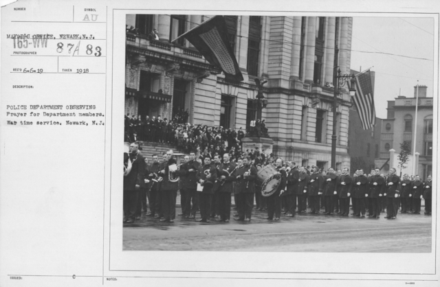 Ceremonies and Parades - Police Department observing prayer for department members.  War itime service.  Newark, N.J