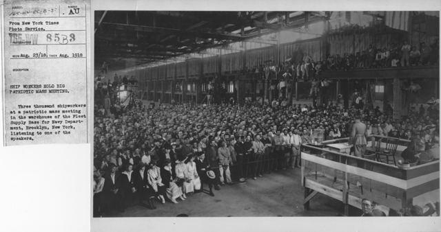 Ceremonies and Parades - Ship workers hold big patriotic mass meeting.  Three thousand shipworkers at a patriotic mass meeting in the warehouse of the Fleet Supply base for Navy Department, Brooklyn, New York, listening to one of the speakers