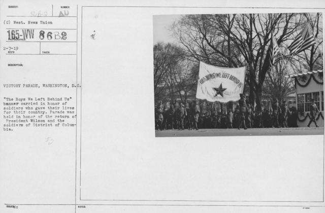 """Ceremonies and Parades - Victory Parade, Washington, D.C.  """"The Boys We Left Behind Us"""" banner carried in honor of soldiers who gave their lives for their country.  Parade was held in honor of the return of President Wilson and the soliders of District of Columbia"""