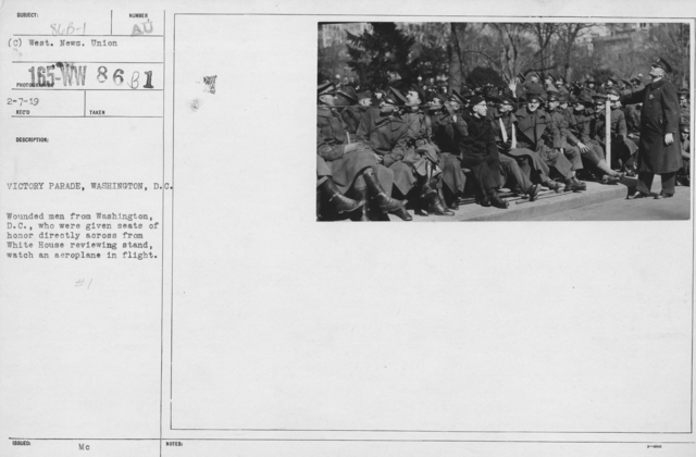 Ceremonies and Parades - Victory Parade, Washington, D.C.  Wounded men from Washington, D.C., who were given seats of honor directly across from White House reviewing stand, watch an aeroplane in flight