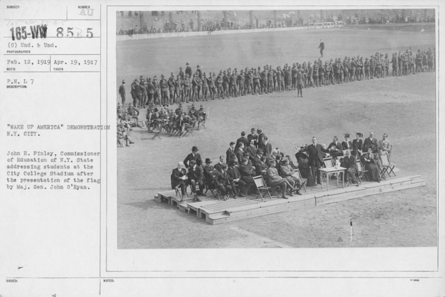 """Ceremonies and Parades - """"Wake Up America"""" Demonstration N.Y. City.  John H. Finley, Commissioner of Education of N. Y. State addressing students at the City College Stadium after the presentation of the flag by Maj. Gen. John O'Ryan"""