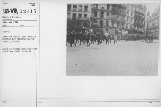 Ceremonies - Bastille Day, 1918 - American troops take part in Bastille Day Celebration in Paris, France. American Troops marching past the Plaza Hotel in Paris