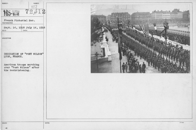 """Ceremonies - Bastille Day, 1918 - Dedication of """"Pont Wilson"""" Lyon, France. American troops marching over """"Pont Wilson"""" after the rechristening"""