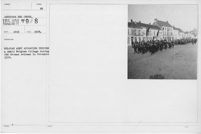 Ceremonies - Belgium - Belgium Army advancing through a small Belgian village during the German retreat in November 1918
