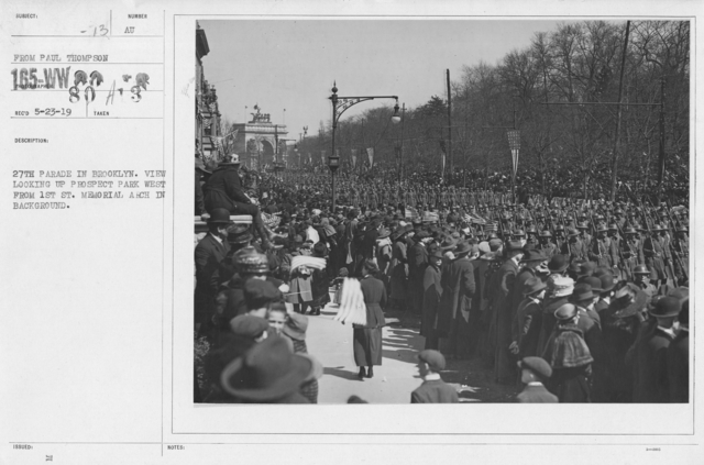 Ceremonies - Demobilization - 27th Parade in Brooklyn. View looking up Prospect Park West from 1st St. Memorial Arch in background