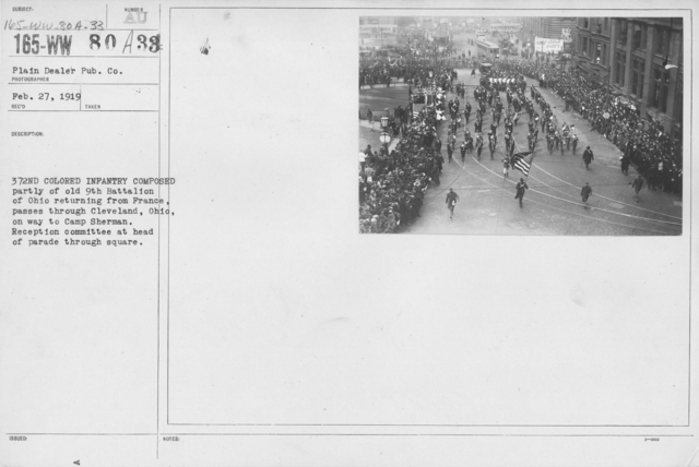 Ceremonies - Demobilization - 372nd Colored Infantry composed partly of Old 9th Battalion of Ohio returning from France, passes through Cleveland, Ohio, on way to Camp Sherman. Reception committee at head of parade through square