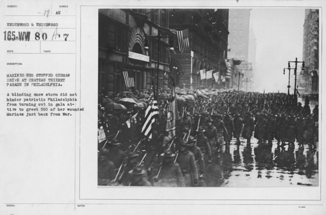Ceremonies - Demobilization - Marines who stopped German drive at Chateau Thierry Parade in Philadelphia. A blinding snow storm did not hinder patriotic Philadelphia from turning out in gala attire to greet 500 of her wounded Marines just back from War