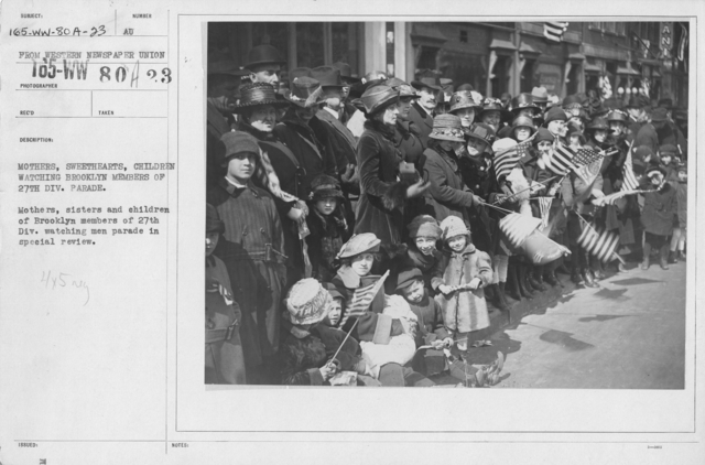 Ceremonies - Demobilization - Mothers, sweethearts, children watching Brooklyn members of 27th Div. Parade. Mothers, sisters and children of Brooklyn members of 27th Div. watching men parade in special review