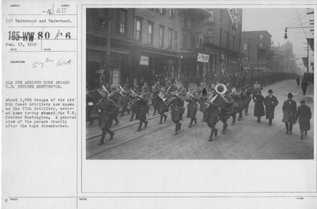 Ceremonies - Demobilization - Old 9th arrives home aboard U.S. Cruiser Huntington. About 1,688 troops of the old 9th Coast Artillery now known as the 57th Artillery, arrived home today aboard the U.S. Cruiser Huntington, a general view of the parade shortly after the boys disembarked