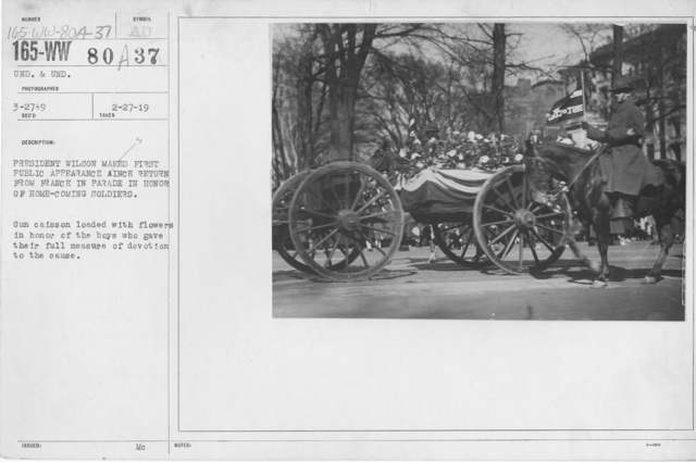 Ceremonies - Demobilization - President Wilson makes first public appearance since return from France in parade in honor of home coming soldiers. Gun caisson loaded with flowers in honor of the boys who gave their full measure of devotion to the cause