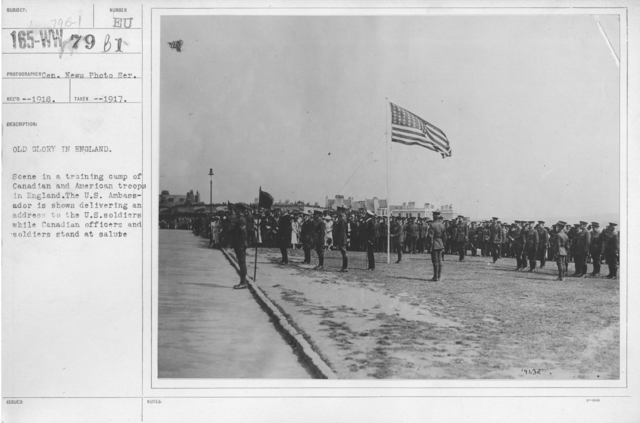 Ceremonies - England - Old Glory in England. Scene in a training camp of Canadian and American troops in England. The U.S. Ambassador is shown delivering an address to the U.S. soldiers while Canadian officers and soldiers stand at salute