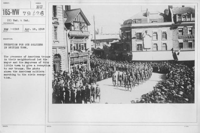 Ceremonies - England - Reception for our soldiers in British town. The presence of American troops in their neighborhood led the Mayor and the Mayoress of this little town to give a reception to our troops. The photo shows the American soldiers marching to the civic reception