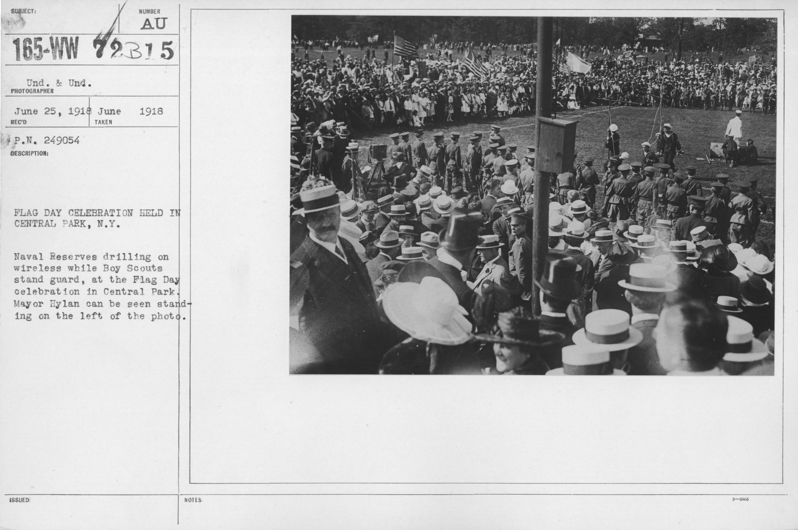 Ceremonies - Flag Day, 1918 - Flag Day Celectration held in Central Park, N.Y. Naval Reserves drilling on wireless while Boy Scouts stand guard, at the Flag Day celebration in Central Park. Mayor Hylan can be seen standing on the left of the photo