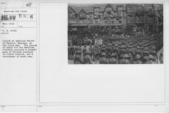 Ceremonies - Foreign - Parade of American troops at Norwich, England, on Red Cross day. The guards of honor for the American visitors included a detachment of British soldiers in trench helmets, and a detachment of naval men