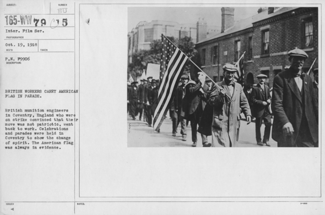 Ceremonies - France - British workers carry American Flag in Parade. British munition engineers in Coventry, England who were on strike convinced that thei move was not patriotic, went back to work. Celebrations and parades were held in Coventry to show the change of spirit. The American flag was always in evidence