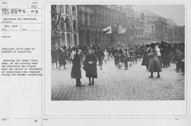 Ceremonies - France - Canadians enters Mons on morning of Armistice. Entering the Grand Place, Mons, on the morning when the armistice was signed amid the cheers of thousands of inhabitants who remained during the German occupation