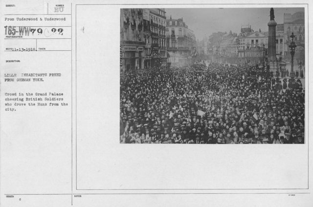 Ceremonies - France - Lille inhabitants freed from German Yoke. Crowd in Grand Palace cheering British Soldiers who drove the Huns from the city
