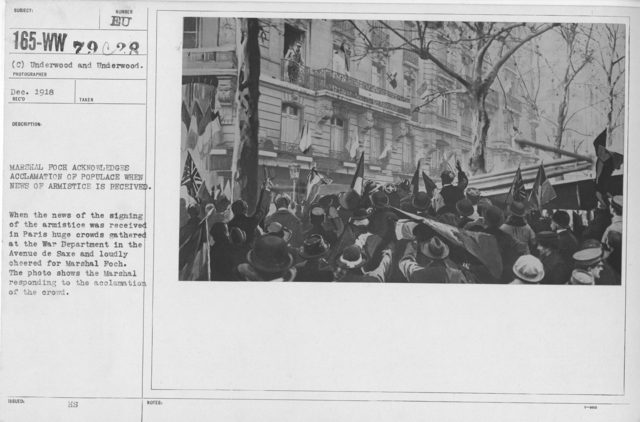 Ceremonies - France - Marshal Foch acknowledges acclamation of populace when news of Armistice is received. When the news of the signing was received in Paris huge crowds gathered at the War Department in the Avenue de Saxe and loudly cheered for Marshal Foch. The photo shows the Marhsal responding to the acclamation of the crowd