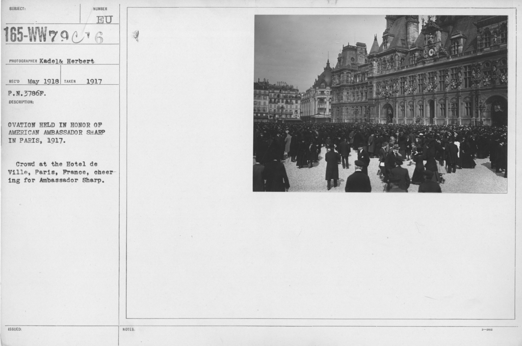 Ceremonies - France - Ovation held in honor of American Ambassador Sharp in Paris, 1917. Crowd at the Hotel de Ville, Paris, France, cheering for Ambassador Sharp