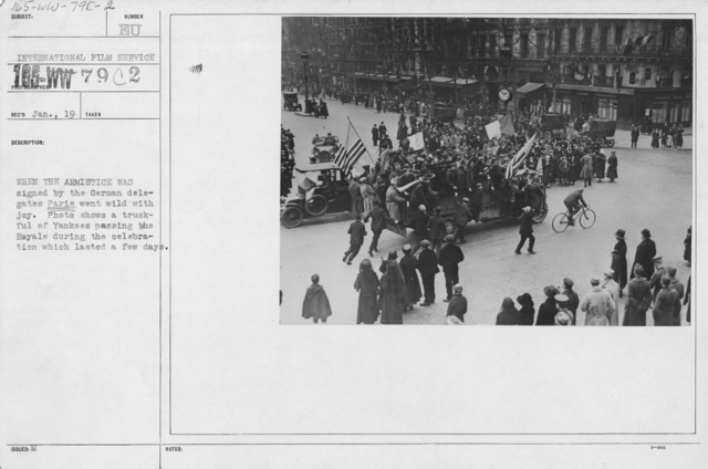 Ceremonies - France - When the Armistice was signed by the German delegates Paris went wild with joy. Photo shows a truckful of Yankees passing the Royale during the celebration which lasted a few days