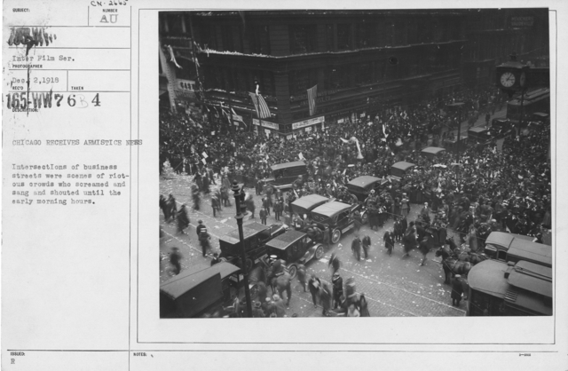 Ceremonies - Illinois - Chicago Peace Demonstrations - Chicago receives Armistice news. Intersections of business streets were scenes of riotous crowds who screamed and sang and shouted until the early morning hours