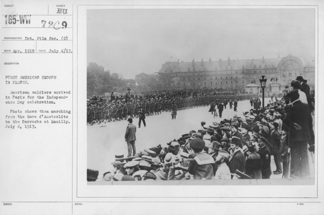 Ceremonies - Independence Day, 1917 - First American Troops in France. American soldiers arrived in Paris for the Independence Day celebration. Photo shows them marching from the Gare d'Austerlitz to the Barracks at Rouilly. July 4, 1917