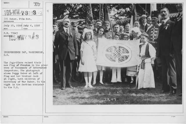 Ceremonies - Independence Day, 1918 - Amer. Misc. - Independence Day, Washington, D.C. The Jugo-Slavs raised their new flag of Freedom in the presence of thousands of interested inspectors. The photograph shows Peggy Baker at left of flag and her brother Jack at right, both children of Secretary of War Baker. To the right is the Serbian Minister to the U.S