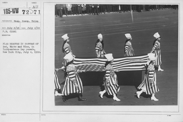 Ceremonies - Independence Day, 1918 - Flag bearers in costume of Red, White and Blue, in Independence Day parade, New York City, July 4, 1918