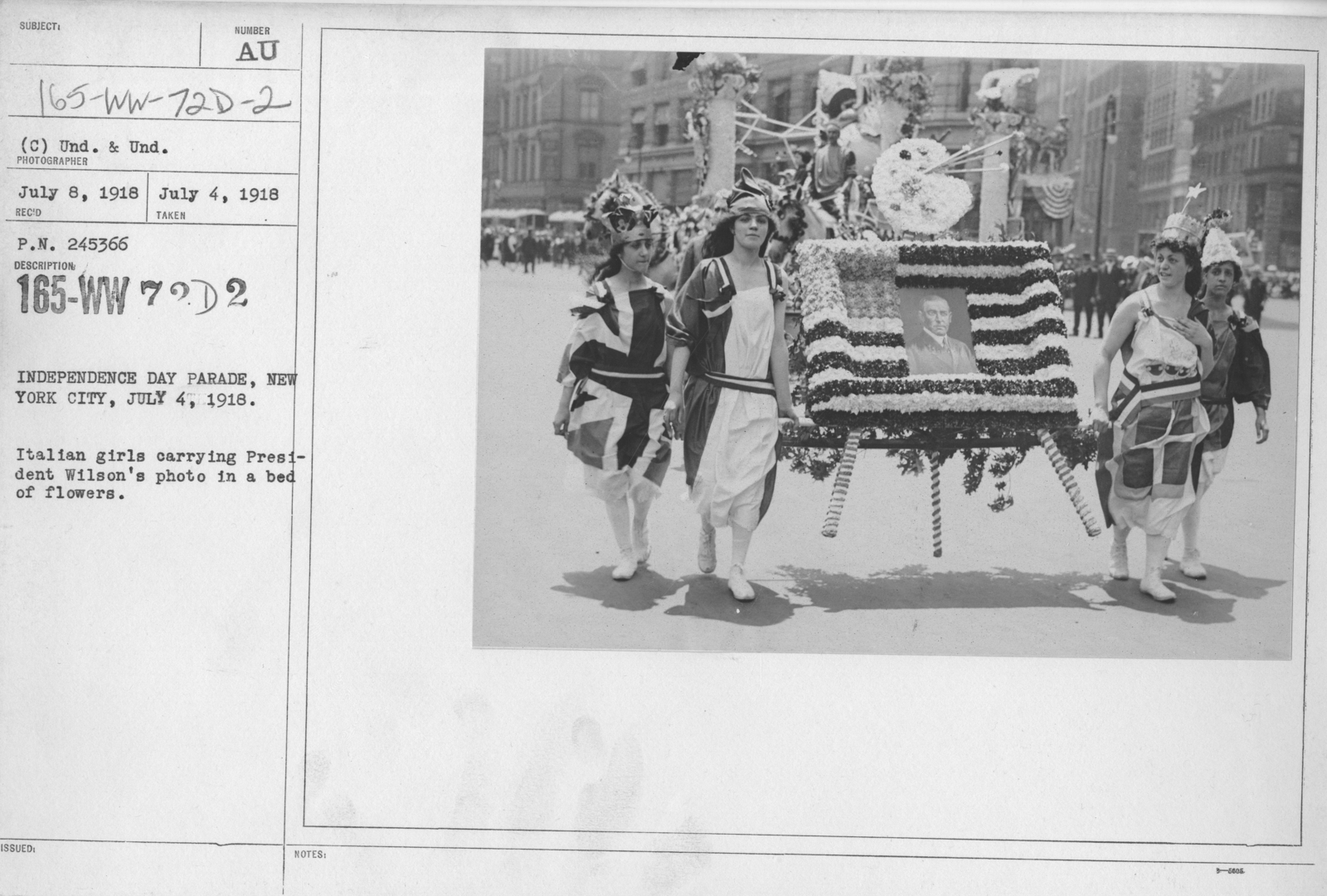Ceremonies - Independence Day, 1918 - Independence Day Parade, New York City, July 4, 1918. Italian girls carrying President Wilson's photo in a bed of flowers