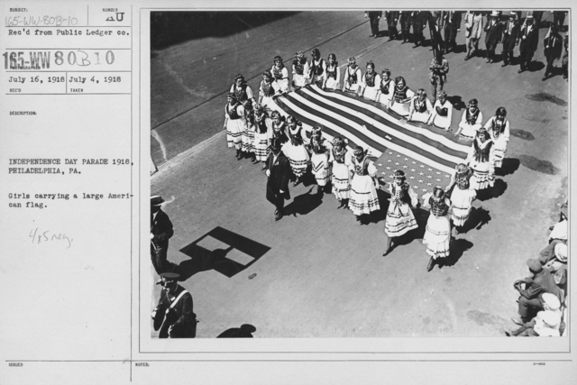 Ceremonies - Independence Day Parades (All States) - Independence Day Parade 1918, Philadelphia, PA. Girls carrying a large American flag