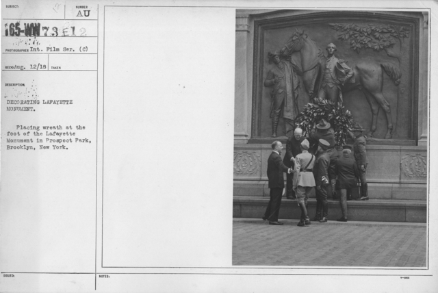 Ceremonies - Lafayette Day, 1918 - Decorating Lafayette Monument. Placing wreath at the foot of the Lafayette Monument in Prospect Park, Brooklyn, New York