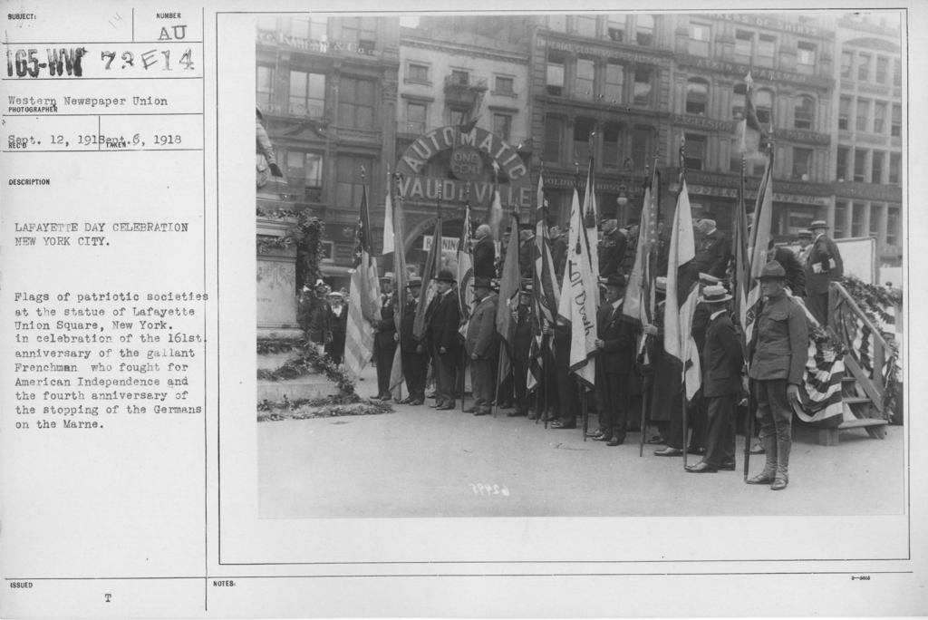 Ceremonies - Lafayette Day, 1918 - Lafayette Day Celebration New York City. Flags of patriotic societies at the statue of Lafayette Union Square, New York. In celebration of the 161st anniversary of the gallant Frenchman who fought for American Independence and the fourth anniversary of the stopping of the Germans on the Marne