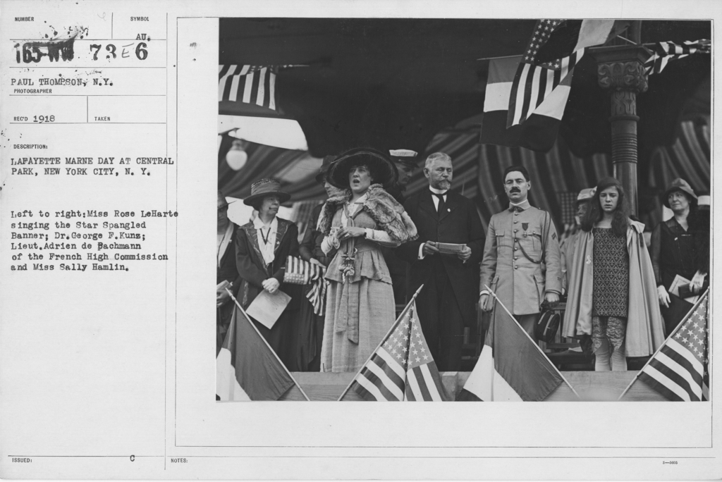 Ceremonies - Lafayette Day, 1918 - Lafayette Marne Day at Central Park, New York City, N.Y. Left to right: Miss Rose LeHarte singing the Star Spangled Banner; Dr. George F. Kunz; Lieut. Adrien de Bachmann of the French High Commission and Miss Sally Hamlin