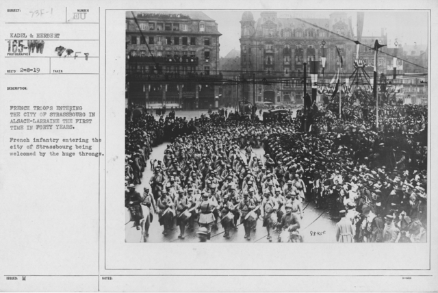 Ceremonies - Liberation of Alsace (Strassbourg) - French troops entering the city of Strassbourg in Alsace-Larraine for the first time in forty years. French infantry entering the city of Strassbourg being welcomed by the huge throngs