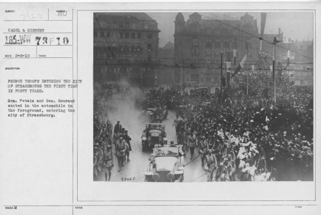 Ceremonies - Liberation of Alsace (Strassbourg) - French troops entering the city of Strassboug the first time in forty years. Gen. Petain and Gen. Gouraud seated in the automobile in the foreground, entering the city of Strassbourg