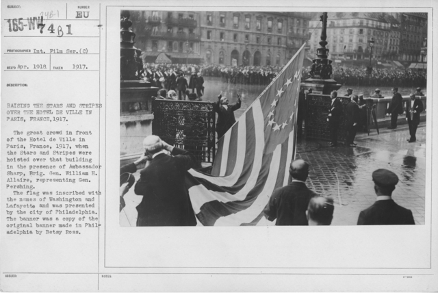 Ceremonies - Liberations - France - Raising the stars and stripes over the Hotel de Ville in Paris, France, 1917. The great crowd in front of the Hotel de Ville in Paris, France, 1917, when the Stars and Stripes were hoisted over that building in the presence of Ambassador Sharp, Brig. Gen. William H. Allaire, representing Gen. Pershing. The flag was inscribed with the names of Washington and Lafayette and was presented by the city of Philadelphia. The banner was a copy of the original banner made inPhiladelphia by Betsy Ross