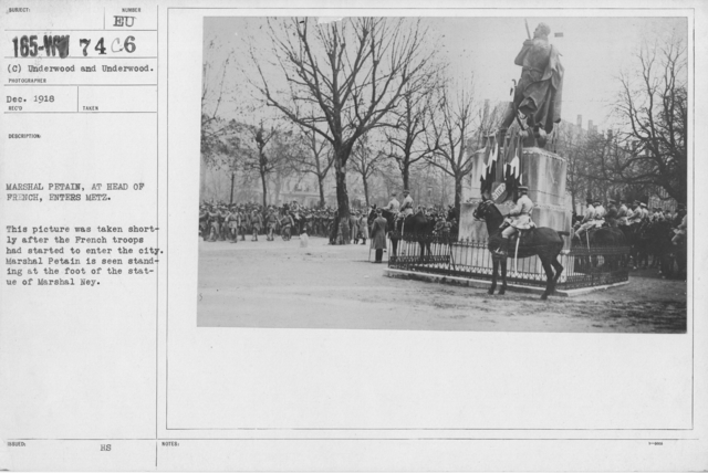 Ceremonies - Liberations - Lorrain-Metz - Marshal Petain, at head of French, enters Metz. This picture was taken shortly after the French troops had started to enter the city. Marshal Petain is seen standing at the foot of the statue of Marshal Ney