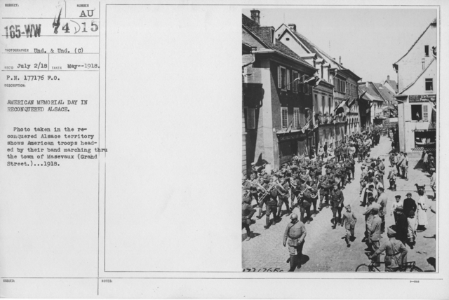 Ceremonies - Liberations - Memorial Day, 1918 - American Memorial Day in reconquered Alsace. Photo taken in the reconquered Alsace territory shows American troops headed by their band marching through the town of Masevaux (Grand Street). 1918