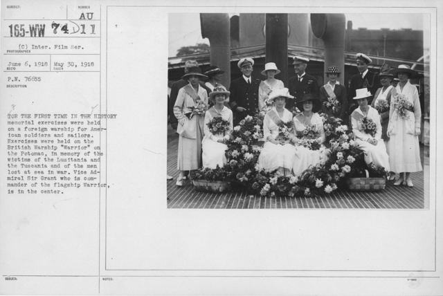 "Ceremonies - Liberations - Memorial Day, 1918 - For the first time in history memorial exercises were held on a a foreign warship for American soldiers and sailors. Exercises were held on the British Warship ""Warrior"" on Potomac, in memory of the victims of the Lusitania and the Tuscania and of the men lost at sea in war. Vice Admiral Sir Grant who is commander of the flagship Warrior is in the center"