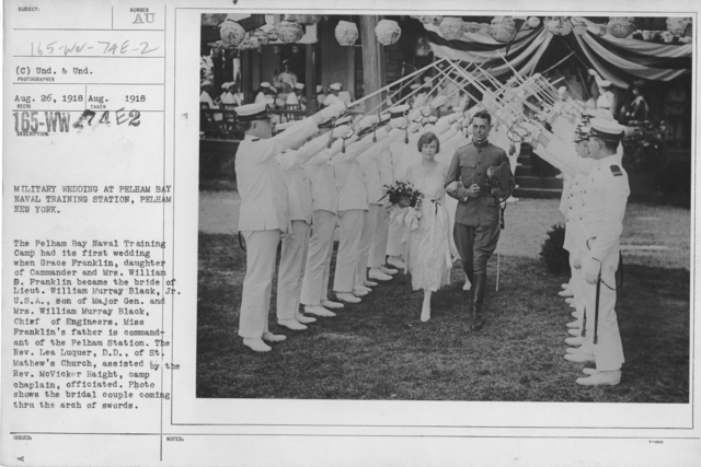 Ceremonies - Liberations - Military Weddings - Military wedding at Pelham Bay Naval Training Station, Pelham, New York. The Pelham Bay Naval Training Camp had its first wedding when Grace Franklin, daughter of Commander and Mrs. William S. Frranklin, became the bride of Lieut. Wm. Murray Black, Jr., U.S.A., son of Major Gen. and Mrs. William Murray Black, Chief of Engineers, Miss Franklin's father is commandant of the Pelham Station. The Rev. Lea Luquer, D.D., of St. Mathew's Church, assisted by the Rev. McVicker Haight, camp camplain, officiated. Photo shows the bridal couple coming through the arch of swords