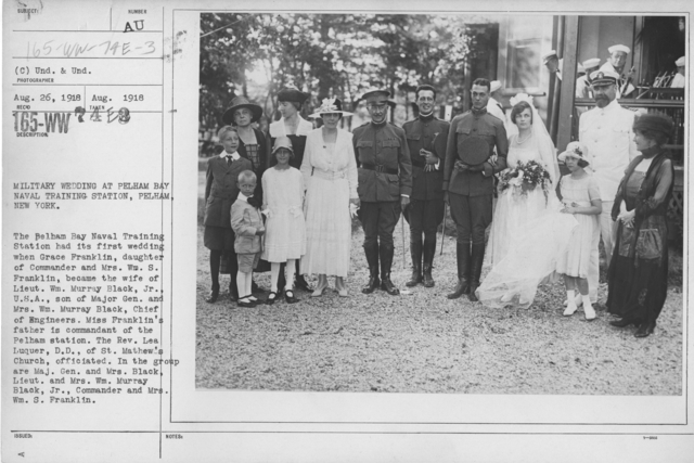 Ceremonies - Liberations - Military Weddings - Military wedding at Pelham Bay Naval Training Station, Pelham, New York. The Pelham Bay Naval Training Camp had its first wedding when Grace Franklin, daughter of Commander and Mrs. William S. Frranklin, became the bride of Lieut. Wm. Murray Black, Jr., U.S.A., son of Major Gen. and Mrs. Wm. Murray Black, Chief of Engineers. Miss Franklin's father is comandant of the pelham station. The Rev. Lea Luquer, D.D., of St. Mathew's Church, officiated. In the group are Maj. Gen. and Mrs. Black, Lieut. and Mrs. Wm. Murray Black, Jr., Commander and Mrs. Wm. S. Franklin
